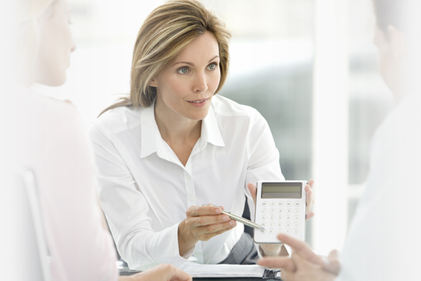 Woman showing calculation Mortgage Advice from Hodson Developments