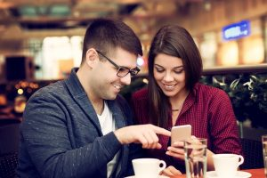 consumer code - Mobile couple look on mobile