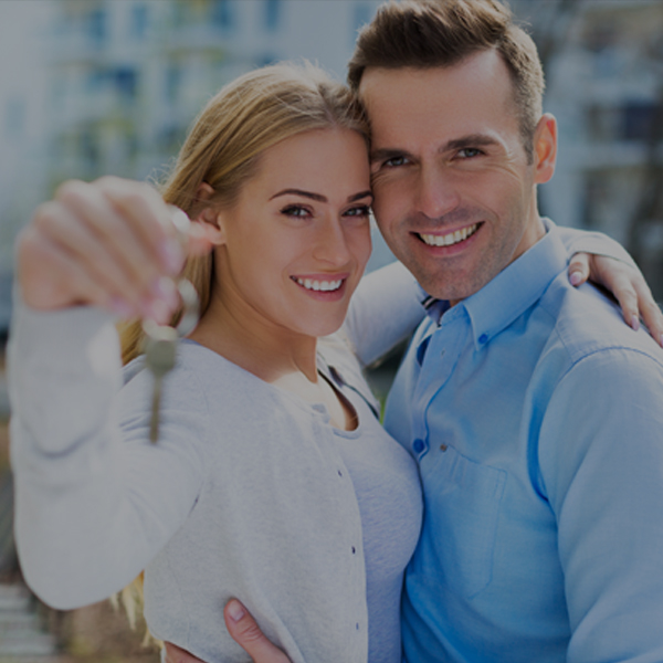 couple holding keys Houses for sale