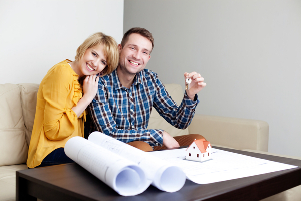 new apartments for sale Off Plan couple looking at plans holding keys