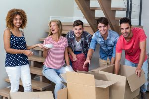 Recommend a Friend Two women and three men unpacking boxes