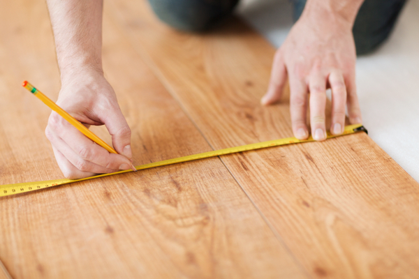 Measuring wood Oak flooring as standard in luxury apartments